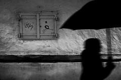 The future starts now (stefankamert) Tags: street umbrella wall people lindau shadow silhouette textures noir blackandwhite blackwhite noiretblanc lines walking ricoh gr grii ricohgr 28mm bw grain motionblur