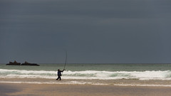 'A cast of thousands ... ' (Canadapt) Tags: man fisherman ocean surf waves cast rock sand beach storm portugal canadapt