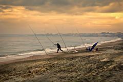 Pesca al tramonto (ninomele) Tags: sunset mare sea canon circeo latina landscapes fisherman 24105mm pesca italy lazio beach spiaggia colors tramonti