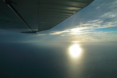 The Sun Skips Off The Sea (peterkelly) Tags: digital canon 6d northamerica gadventures mayandiscovery belize cayecaulker plane airplane caribbeansea aerialphotography aerialphotos wing sun reflection water