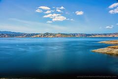San-Luis_Reservoir_01 (DonBantumPhotography.com) Tags: landscapes lake reservoir sanluisreservoir blue clouds water hills donbantumphotographycom donbantumcom mercedcountycalifornia blueskies