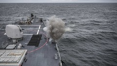 USS Carney (DDG 64) fires its Mark 45 5-inch gun during a live-fire exercise, May 2, 2019.