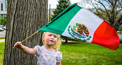 Cinco De Mayo celebration - Pondering the flag (TedNorton1) Tags: flag mexico may cincodemayo girl cute ponder downtown green red white eagle mexican 5th celebration celebrate heritage people portrait city frame colorado capital mirrorless tree meaning