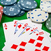 Cards and chips on a green background. Card gambling concept