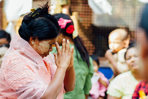 Woman Praying at Nat Pwe Ceremony, Mandalay Myanmar