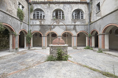 Convento Sussurante (Jonnie Lynn Lace) Tags: abandoned italy italia italian trip travel europe european convent convento decay derelict detail details d750 nikkor nikon green naturetakesover well exploration exterior explore explorer texture textures design architecture arches old history time memories windows breezeway lines jonnielace digital flickr vines red stone