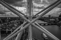 View of the Thames (mlk.dahoui) Tags: london thames high eye westminster nikon structure bridge sky clouds horizon lights boat water bw monochrome nikonflickraward travel
