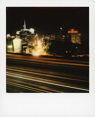 101 & Vine 4 (tobysx70) Tags: polaroid originals color sx70 instant film sx70sonar sonar 101 vine street hollywood los angeles la california ca freeway el camino real traffic cityscape neon sign night nocturnal lighttrails city lights capitol records building knickerbocker vanishing point motion blur toby hancock photography