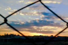 Through The Metal Fence (Lea Ruiz Donoso) Tags: sunset puesta sol metal metallic fence 2016 paisajeurbano clouds cielo sky españa spain madrid