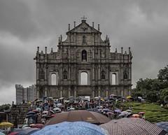 St Paul's Ruins, Macau  (In Explore) (Wormsmeat) Tags: macau rain umbrellas hongkong bad weather olympus 12100mzuikopro penf clouds touristattraction facade