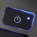 Close-up of a glowing power button on a laptop