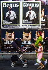 Street - Negus (François Escriva) Tags: street streetphotography paris france people candid olympus omd photo rue woman colors sidewalk pushchair trolley buggy baby child green pink billboard poster negus magazine black white