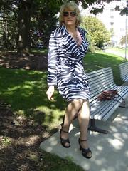 From 2011, An Attempt At Camouflage (Laurette Victoria) Tags: raincoat zebrastripe blonde woman laurette milwaukee downtown sunglasses