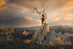 What Remains ({jessica drossin}) Tags: jessicadrossin wwwjessicadrossincom face portrat portrait woman dress mountains sky clouds sunset rocks boulders sage brush stick idaho