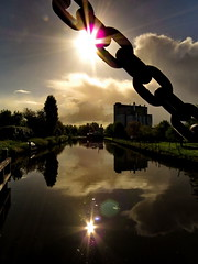 Gekanaliseerde Hollandse IJssel (Mattijsje) Tags: holland wilhelminavanpruisenbrug hekendorp fietsersbrug bridge gekanaliseerdehollandseijssel ijssel flowers spring bicycle flare sun reflection reflectie water silhouette clouds desamenwerking