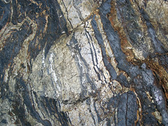 Folded-faulted banded iron formation (Temagami Iron-Formation, Neoarchean, ~2.736 Ga; Temagami North roadcut, Temagami, Ontario, Canada) 14 (James St. John) Tags: temagami ontario canada precambrian archean neoarchean banded formation bif magnetite quartz fault faults fold folds folded faulted