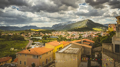 Posada, Sardinia, Italy (David Lea Kenney) Tags: town townscape towns explore travel mountain mountains landscape houses house road roads rural inland sardinia sardegna italy italia townshots landscapeshots landscapepics travepics a7r3 sony clouds cloud grass sunlight