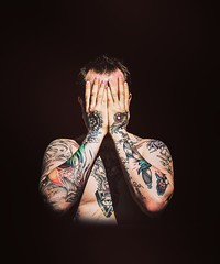 Now you can't see me! (Lorre_1) Tags: europe 50mm canon sweden light sunlight tattoo man portrait