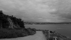 The Way Home (Rand Luv'n Life) Tags: odc our daily challenge flickr love point loma cabrillo national monument park lower bay side trail rock rope fence bushes hillside storm clouds vista downtown san diego skyline boat wake monochrome blackandwhite outdoors