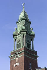 The bell tower of St. Cyril and Methodius Catholic Church in Northeast Minneapolis, Minnesota - The 1917 brick church was designed by Victor Cordella in the Renaissance Revival style with an elaborate Baroque bell tower. (thstrand) Tags: 1900s 19101919 1917 20thcentury american architecturalstyles architecture baroque belltower brick building buildings builtstructure builtsstructures catholicchurch christian christianity churches copper corroded corrosion exterior front greenmetal hennepincounty historicsite history landmark landmarks mn minneapolis minnesota ne neminneapolis nobody northamerica northeast outside religion religious religiousarchitecture renaissancerevivalstyle romancatholic sscyrilandmethodius saintcyril saintmethodius saints slavic stcyrilandmethodiuscatholicchurch tower towers us usa unitedstates victorcordella
