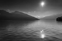 B&W Lake View - Switzerland (pa_cosgrove) Tags: bw lake mountains water sky clouds sun reflections switzerland sony a73