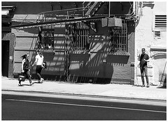 Daily Routine (Demmer S) Tags: street streetphotography people walking standing streetshots documentary citylife pedestrian peoplewatching shootthestreet streetlife candid candidstreet person urban city outside urbanphotography streetscene urbanexploration outdoors pavement curb architecture fireescape lines shadow shadows light sun sunny border frame photoborder framed ny newyork nyc newyorkcity manhattan eastcoast bw monochrome blackwhite blackandwhite blackwhitephotos blackwhitephoto