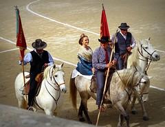 Les Gardians et la Camarguèse (aficion2012) Tags: défilé gardians gardiens camargue cheval chevaux tradition cotumes people camarguese arles francia france provence parade desfile woman men horses
