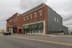 Buildings — Columbus Grove, Ohio (Pythaglio) Tags: buildings structures historic twostory columbusgrove ohio unitedstatesofamerica brick putnamcounty infill sidewalk street clouds cornice brackets italianate storefronts altered remodeled