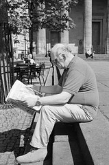 Read Between the Lines (Mano Green) Tags: newspaper reading man shoes elgin scotland uk may spring 2016 canon eos 300 40mm lens ilford hp5 400 35mm film street black white