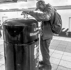 Trying to survive on the subway (Capitancapitan) Tags: neury luciano el mundo gira cantautor urim y tumim pop rock cinco segundos subway tren pentax apple street photography camera black white nyc new york city manhattan brooklyn bronx people tv radio shows survaving