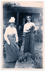Two Ladies in the Garden (pepandtim) Tags: postcard old early nostalgia nostalgic two ladies garden mother daughter path slats dog flower bed cat 46tlt52