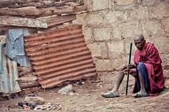 Echoes (u c c r o w) Tags: maasai portrait old man colors rust wall bricks street streetlife streetphotography urban urbanlife tanzania africa african native