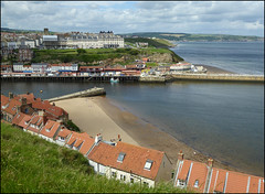 Whitby coastline. (Country Girl 76) Tags: whitby yorkshire seaside view sand houses pier clouds