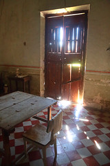 Leaky Door (peterkelly) Tags: digital canon 6d northamerica gadventures mayandiscovery mexico yucatán mérida haciendauayalceh church chapel abandoned derelict sunlight sun light door table chair