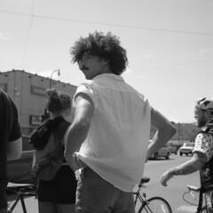 untitled (kaumpphoto) Tags: rolleiflex 120 tlr ilford bw black white street urban city man hair afro shirt minneapolis moustache
