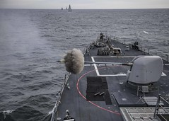USS Carney (DDG 64) fires its Mark 45 5-inch gun while participating in a live-fire exercise during Formidable Shield 19, May 13, 2019. (Official U.S. Navy Imagery) Tags: usscarneyddg64 us6thfleet c6f fdnf formidableshield nato iamd atlanticocean