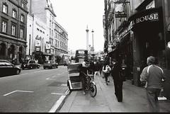 London (goodfella2459) Tags: nikonf4 afnikkor24mmf28dlens ilfordhp5plus400 35mm blackandwhite film analog city streets road buildings pedestrians london bwfp