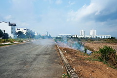 . (Out to Lunch) Tags: thanhmyloy thu thiem district 2 new saigon ho chi minh city vietnam street fire smoke rice fields sky blue brown urban suburban fuji xh1 xf218r