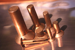 Reflecting copper in Engineering. (Yesteryear-Automotive) Tags: copperrivets copper rivet metalwork metal engineering engineeringartifacts rivetingphotography reflections stilllife macromondays