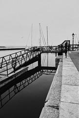 (a.pierre4840) Tags: olympus om2n zuiko 24mm f28 kodaktrix 400iso reflection harbour pooleharbour poole dorset england lines bw blackandwhite monochrome noiretblanc 35mmfilm