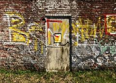 Graffiti exercises (rob kraay) Tags: oldweatheredstonewall doorframe robkraay grass doorhandle wornoutwoodendoor doorhinges wall graffiti