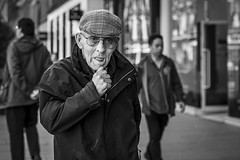 The Pondering (Leanne Boulton) Tags: people portrait urban street candid portraiture streetphotography candidstreetphotography candidportrait streetportrait eyecontact candideyecontact streetlife old elderly man male face eyes expression emotion mood eyelashes glasses cap hand gesture tone texture detail depthoffield bokeh naturallight outdoor light shade city scene human life living humanity society culture lifestyle canon canon5dmkiii 70mm ef2470mmf28liiusm black white blackwhite bw mono blackandwhite monochrome glasgow scotland uk