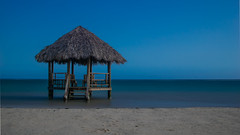 Jamaican Hut (omeiscl) Tags: sand beach sky hut sea ocean longexposure jamaica