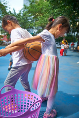 4-6 Yr Old Basketball English Lesson 17 (ArdieBeaPhotography) Tags: boy girl child kids children kindergarten preschooler elementary school age play basketball shoot throw catch pass toss ball leap jump tights white rainbow gauzy skirts trousers shorts shirt tshirt blue glasses court trees shadow leaves tummy navel button bare exposed sandals trainers shoes trackpants outside class learning teaching englishlesson black hair cute pretty beautiful handsome enthusiastic game energetic excited together tamronspaf2875mmf28xrdildasphericalif