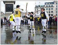 Jump to it (donbyatt) Tags: london westminster morrisdancing trafalgarsquare rain wet people candid street dancing dayofdance2019