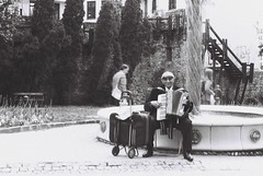 busker with accordion (viktor.rpprt) Tags: busker outdoor man musician accordion fountain pécs pentax 35mm bnwphotography fomapan iso100 50mm film filmphotography filmphoto filmisalive filmcamera thefilmcommunity thefilmgang kodakfilm shootfilm keepfilm shootfilmstaybroke shotonfilm believeinfilm grain analogfilm ishootfilm filmisnotdead vintagecamera