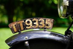 """TT9335"" (Eric Flexyourhead) Tags: vancouver canada britishcolumbia bc vandusenbotanicalgarden 2019 allbritishfieldmeet abfm bike motorbike motorcycle detail fragment british english ajs ajstevenscoltd antique vintage retro licenseplate numberplate rust rusty corroded corrosion weathered worn patina shallowdepthoffield bokeh sonyalphaa7 zeisssonnartfe55mmf18za zeiss 55mmf18"