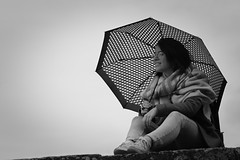 A dream (N.Hell) Tags: girl woman beautiful pretty portrait umbrella monochrome black white bw natural light mood canon 50d sigma 105mm look sky rain