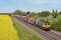 66705 Golden Jubilee (Paul268869) Tags: 66705 goldenjubilee 4e34 southamptonwesterndocks doncasteriport barrowupontrent derbyshire england greatbritain theworld planetearth paulmanley canon intermodal gbrf generalmotors emd gm landscape sun sky transport vehicle loco summer spring may 2019 colour color art tree nature sony digitalphotography picture camera britishfreighttrain europe field rapeseed light engine track railroads cloud orange yellow green blue red box wagon truck container