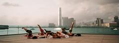 Yoga Skyline (stevenwonggggg) Tags: xpan hasselblad film fuji industrial 100 yoga skyline hongkong urban sport analog